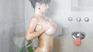 Busty MILF playing with her pussy in shower